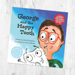 george and the happy tooth book on a table